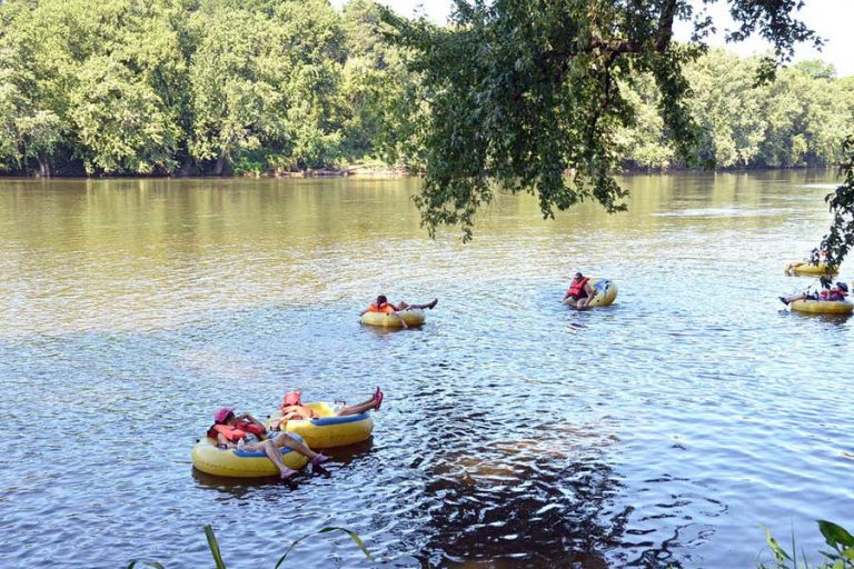 A group tubing down the San Marcos river