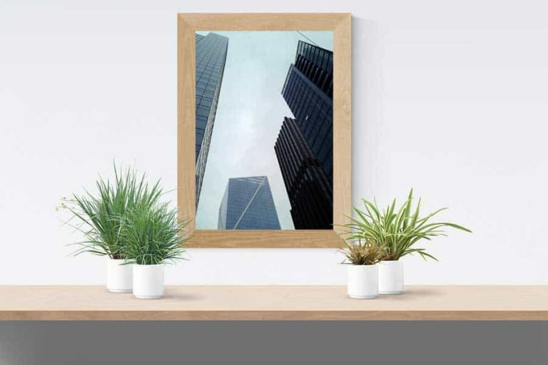 A poster of a city skyline framed and hanging on a wall