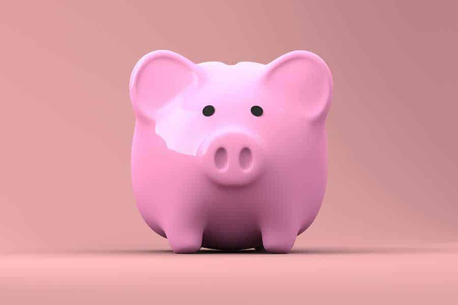 Financing the purchase of a home, symbolized by a piggy bank