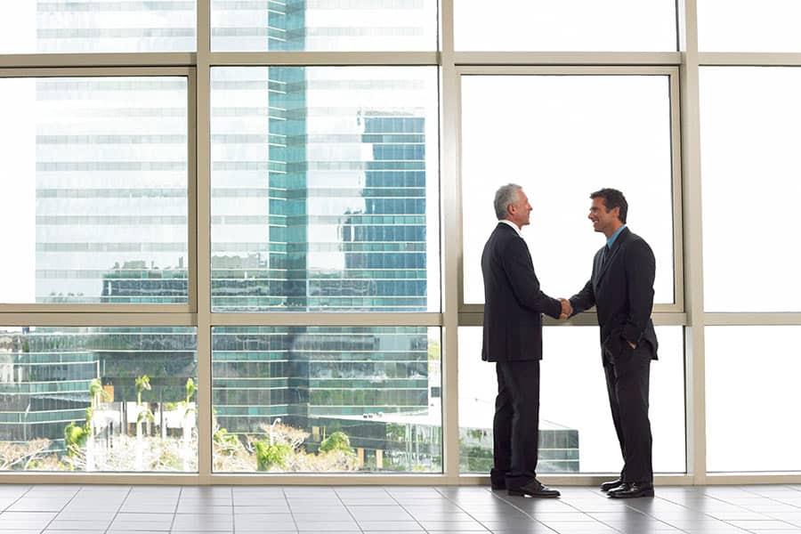 2 Men Shaking hands in Commercial Building