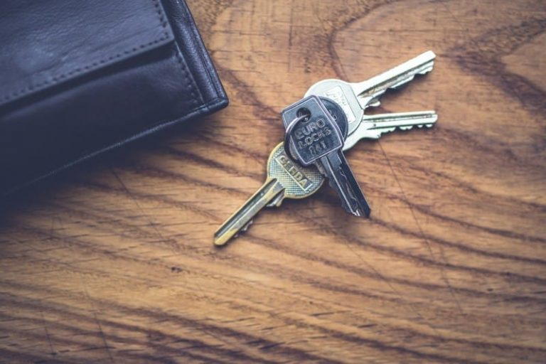 House keys and wallet on wooden table in San Marcos Texas home for sale