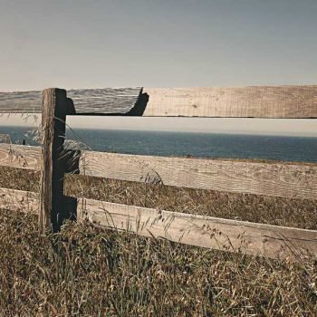 Wooden fence overlooking vacant lot for sale