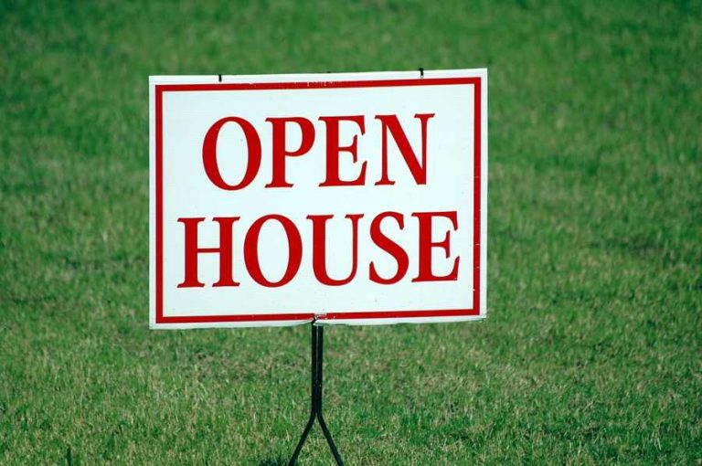 San Marcos real estate open house sign on green lawn