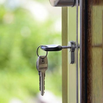 A key opening a home's front door