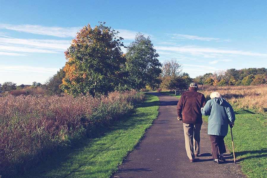 A retired couple enjoying a leisurely walk
