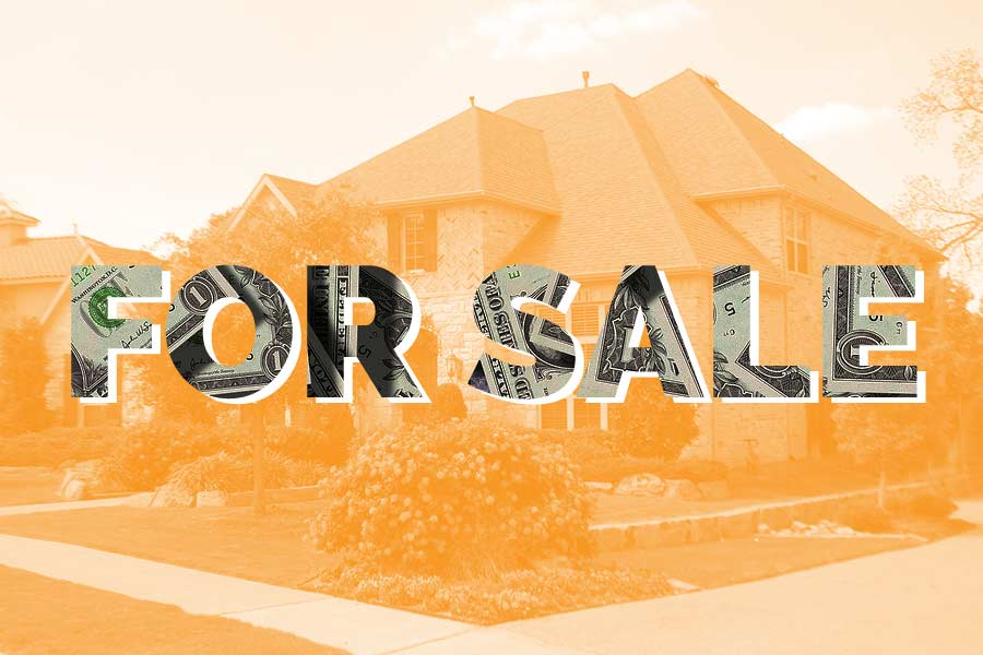 """""""For Sale"""" sign in front of a house"""