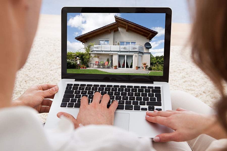 Couple looking at homes for sale on a computer