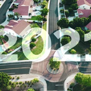 "The text ""2021"" overlaid on an aerial shot of houses"