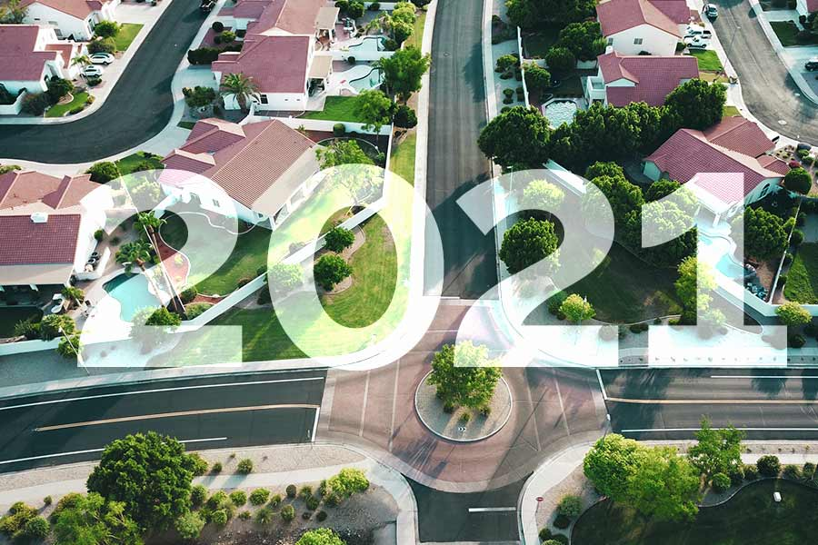 """The text """"2021"""" overlaid on an aerial shot of houses"""