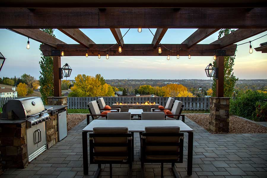 Brand new backyard deck with a table and seating